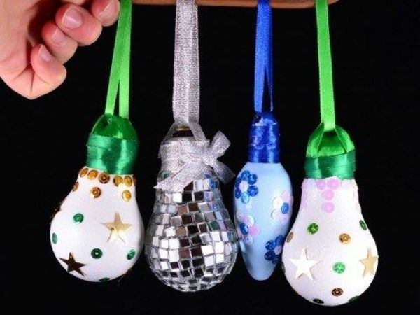 light bulbs decorated with sequins and ribbons