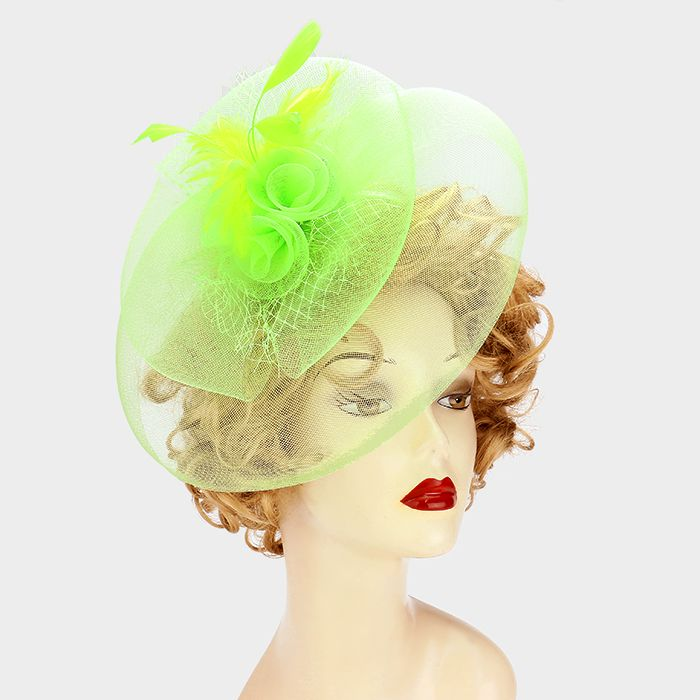 This lime green fascinator is the perfect piece for those Derby day parties that you have coming up. Browse the huge selection at Ginga's Galleria today!