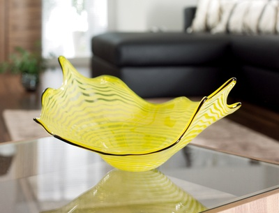 Hand crafted using traditional glass blowing production techniques, the yellow Wave bowl takes its inspiration from the lotus leaf, an emblem of purity and beauty.