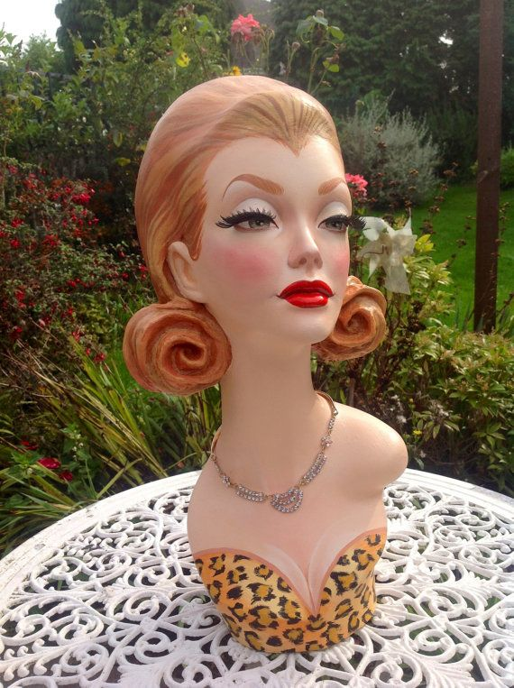 This is a lovely mannequin head with blonde hair from Etsy.