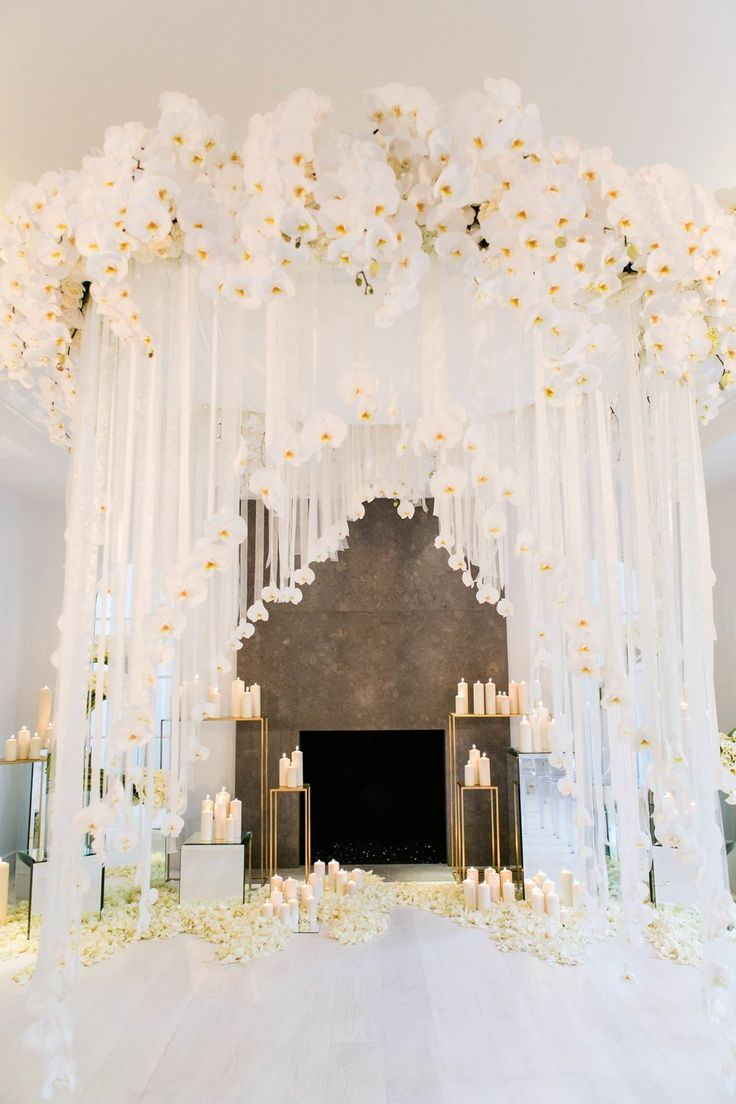 Amazing Orchid & Candle Ceremony Décor | Photo: Courtesy of White Lilac Inc.
