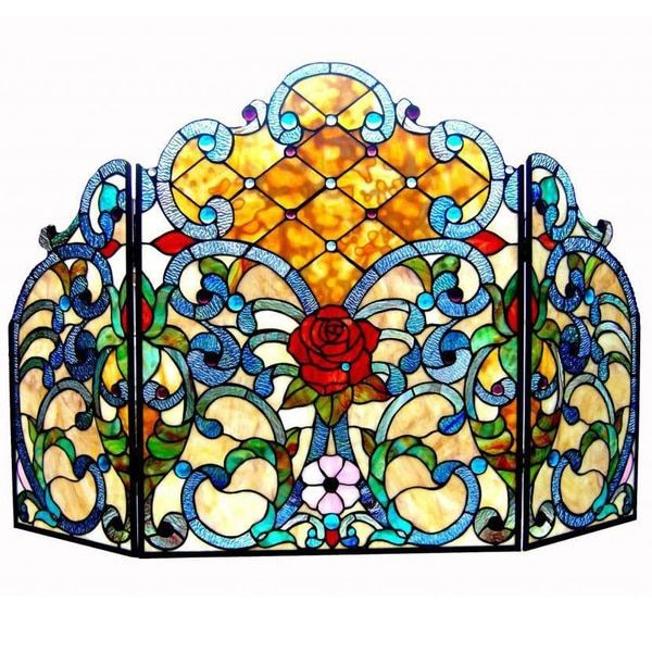 This Tiffany style rose and Victorian fireplace screen features over 500 hand cut pieces of art glass and Cabeshons. The delicate design will add warmth and color to any room as well as complement man