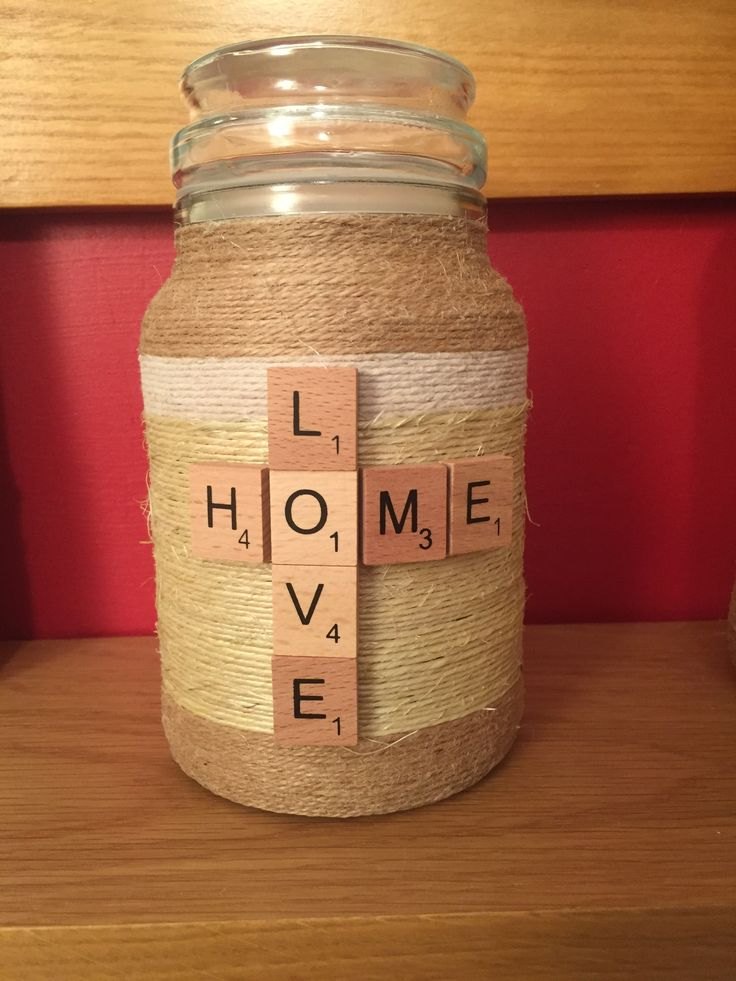 String covered jar with scrabble letters .. Cute