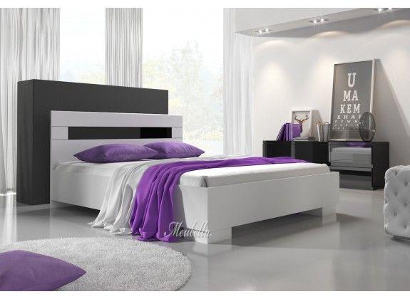 Bed Dual - Wit / Zwart Tweepersoonsbed vervaardigd uit wit hout met zwarte hoogglans strepen. Het bed is verkrijgbaar in de maat (let op: matrassen worden niet meegeleverd!):  140x200  Het bed wordt met standaard lattenbodem geleverd. https://www.meubella.nl/slaapkamer/bedden/tweepersoonsbedden/tweepersoonsbed-dual-wit-140x200-cm.html