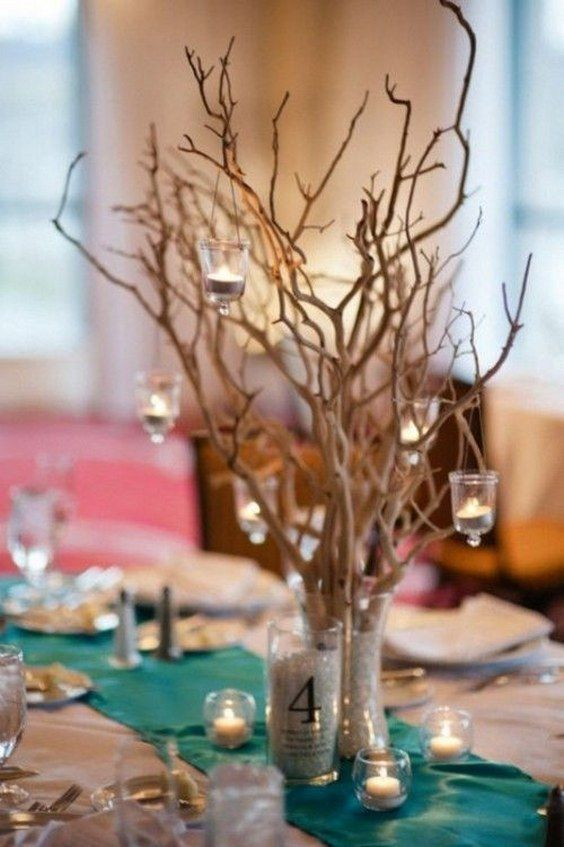 rustic beach candles and tree branches wedding centerpiece / http://www.deerpearlflowers.com/twigs-and-branches-wedding-ideas/