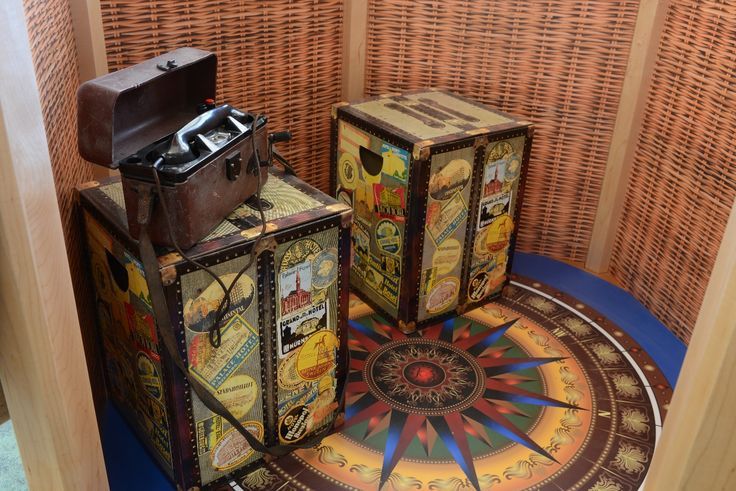 A compass rose decorates the base of the balloon interior. A retro telephone offers fun and fantasy for children and trunk seating completes the picture