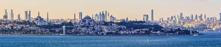 Panoramic view of Istanbul from the confluence of the Bosphorus and the Sea of Marmara. Several landmarks—including Sultan Ahmed Mosque, the Hagia Sophia, Topkapı Palace, and Dolmabahçe Palace—can be seen along their shores.