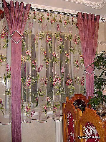 Love this idea. I'd get a longer sheer curtain. Would look nice in the kitchen window.