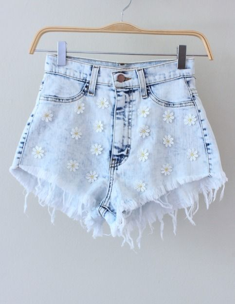 RESTOCKED APRIL 29th!  Our popular denim high-waisted shorts are back with the same perfect fit, now embellished with daisies! Shorts are made of a stretchy denim material, high-waisted with distressed hem.  Tiny daisies sewn on front. Shorts have faux front pockets and usable back pockets.  ...