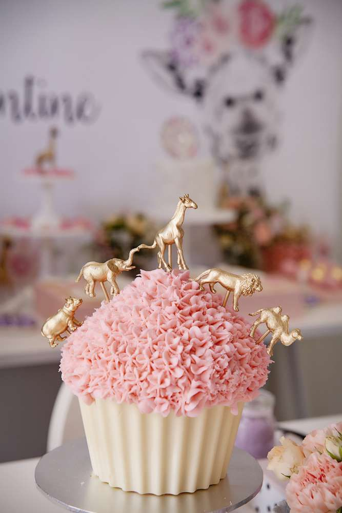 Gold animals atop a cupcake at a giraffe party! See more party planning ideas at CatchMyParty.com!