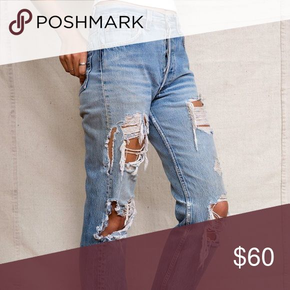 Levi's Woman's distressed jeans. Very good condition. Worn a couple of time, look a little more distressed because they've been washed a few times but are beautiful. Extremely similar to picture. Originally bought from urban outfitters Urban Outfitters Jeans Boyfriend