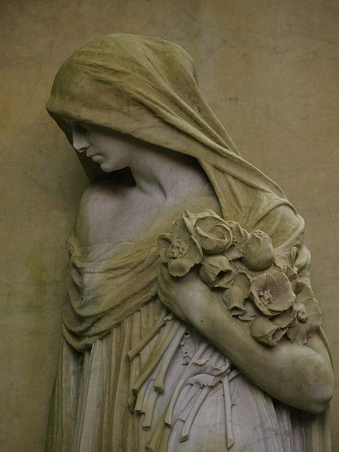 """""""Beauty with flowers and cape    Discovered in Hamburg, Germany, Friedhof Ohlsdorf, the largest park cemetery of the world"""""""