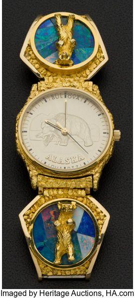 Timepieces:Wristwatch, Bulova Gent's Gold Nugget & Opal Wristwatch. ...