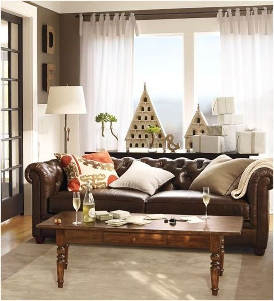 Study Retail Styling. Pottery Barn does an exceptional job of styling leather sofas in a room scene – take a cue from the way retail stylists layer with pillows and throw blankets and then surround it with different furniture and artwork with varying colors and textures.