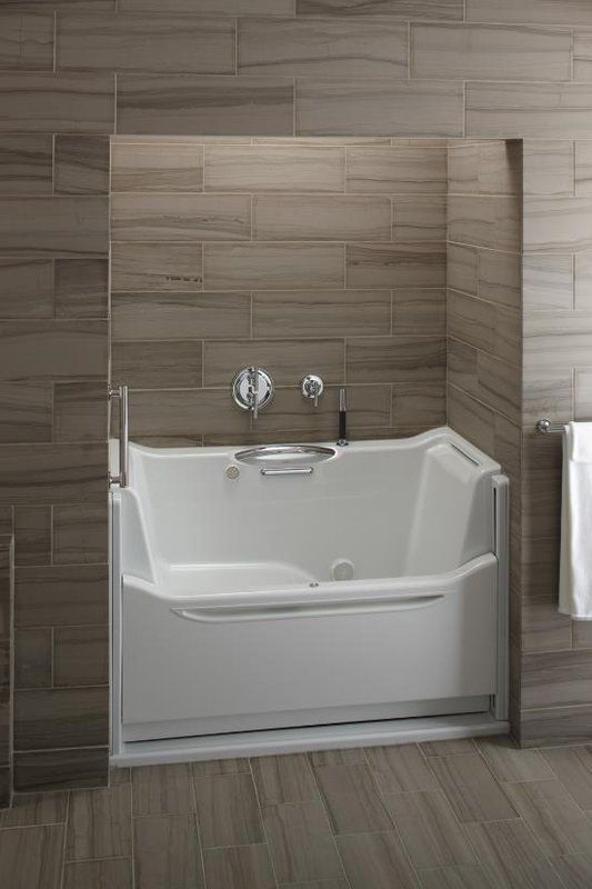 Kholer 60  Rising Wall Soaking Bath Tub A stylish alternative to walk in Best 25 Standard tub size ideas on Pinterest Shower pans and