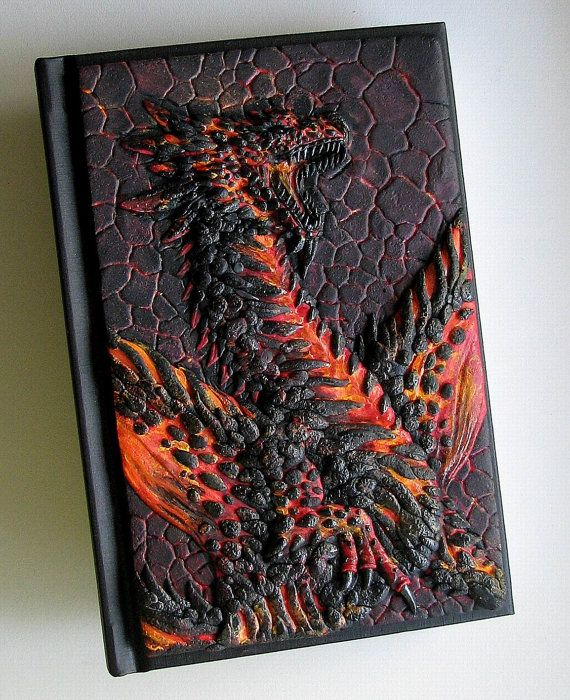 Its a unique notebook with handmade polymer clay cover - fantasy lava dragon . Notebook has 98 white sheets (Canson Art Book One). You could use it as journal or diary or sketchbook. If you looking extraordinary gift - you find it :-) Format : A6. Dimensions : 10.8 x 15.8 cm.