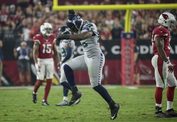 Seahawks tie the Cardinals, 6-6, in OT  -  October 23, 2016:     Seattle Seahawks defensive end Cliff Avril (56) celebrates after sacking Arizona Cardinals quarterback Carson Palmer (3) for a loss in the first quarter. (Bettina Hansen / The Seattle Times)