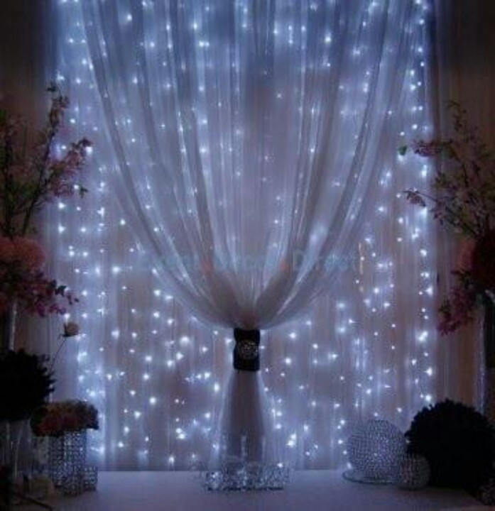 String mini lights onto curtain rod & cover with sheer fabric ...