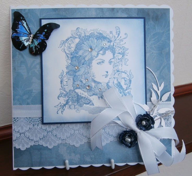 Indigo Blu stamp,stamped and coloured with distress ink, butterfly stamped and coloured with cosmic shimmer