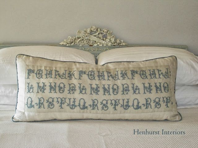 Lovely French bed with needlework pillow - design by Henhurst Interiors