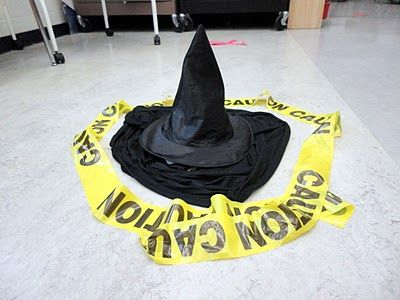 The Wizard of Oz : witch's garb with caution tape- YA room for when The Great and Powerful Oz comes out