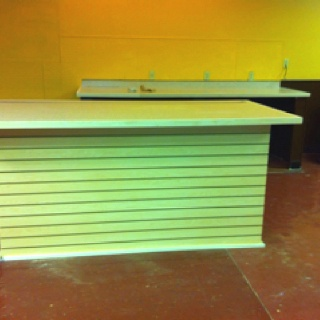refaced check out counter it has a new laminate counter top on it and slat wallcounter