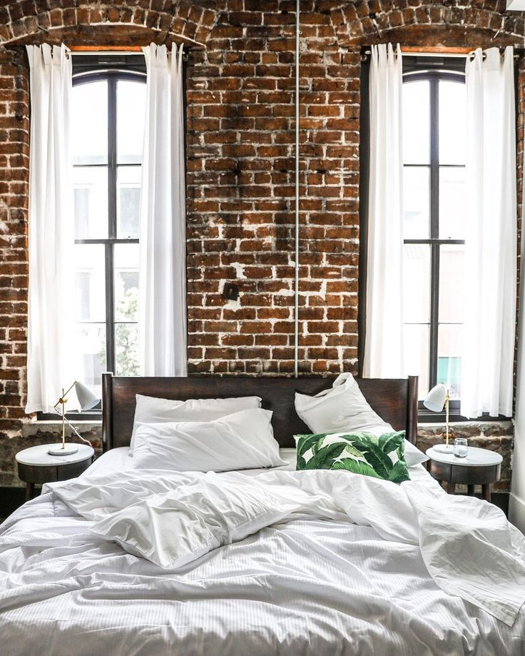 Contemporary Loft Apartment Bedroom Design with Exposed Brick Walls and Large, Dramatic Windows