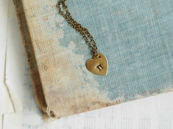 I LOVE Pi . . . . This is a fun golden heart charm necklace with the Greek letter Pi hand stamped on the heart. The heart hangs from a delicate