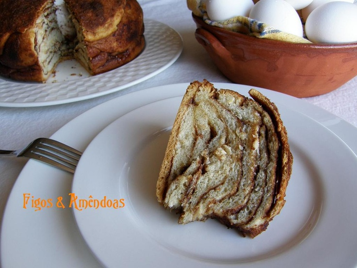Folar da Pascoa- Traditional Easter cake. This version is traditionally from Algarve in the South of Portugal. In other regions different versions are found. Both are baked with an egg inside. This version has layers of dough lined with brown sugar, cinnamon, anis seeds, and butter.
