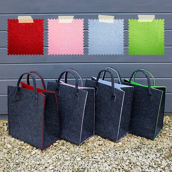 A stunning dark grey felt bag with a contrasting coloured inner. This simple and stylish felt bag makes the perfect gift for a girlfriend or sister