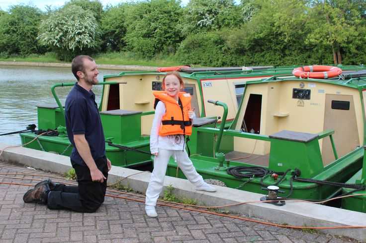 A younger member of the crew being fitted with a lifejacket prior to  climbing aboard for their holiday.   www.calcuttboats.com