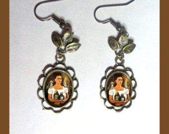 Items similar to Iconic Mexican Silver Sacred Flaming Heart Earrings with Skulls, Pink Glitter, and Resin - Corazon Sagrado on Etsy