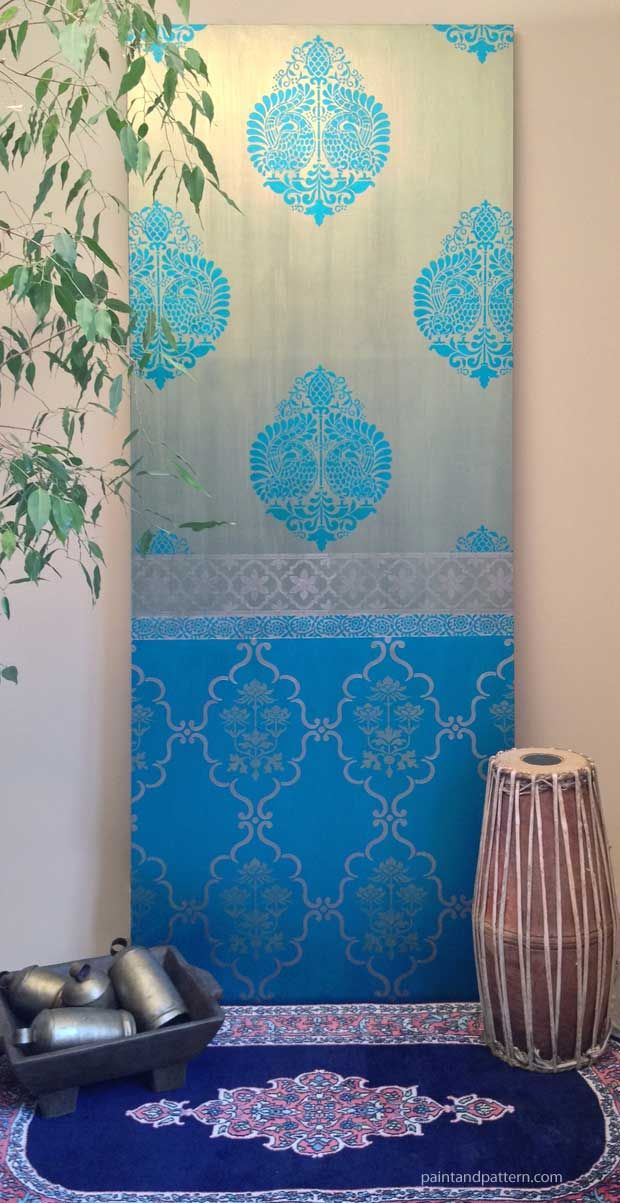 Can you believe this was painted with only three colors? It's true! See the DIY to paint a sari-inspired stenciled panel with only a few colors, but looks like a lot more.  Inspired by Saris: A Shimmery DIY Stenciled Door