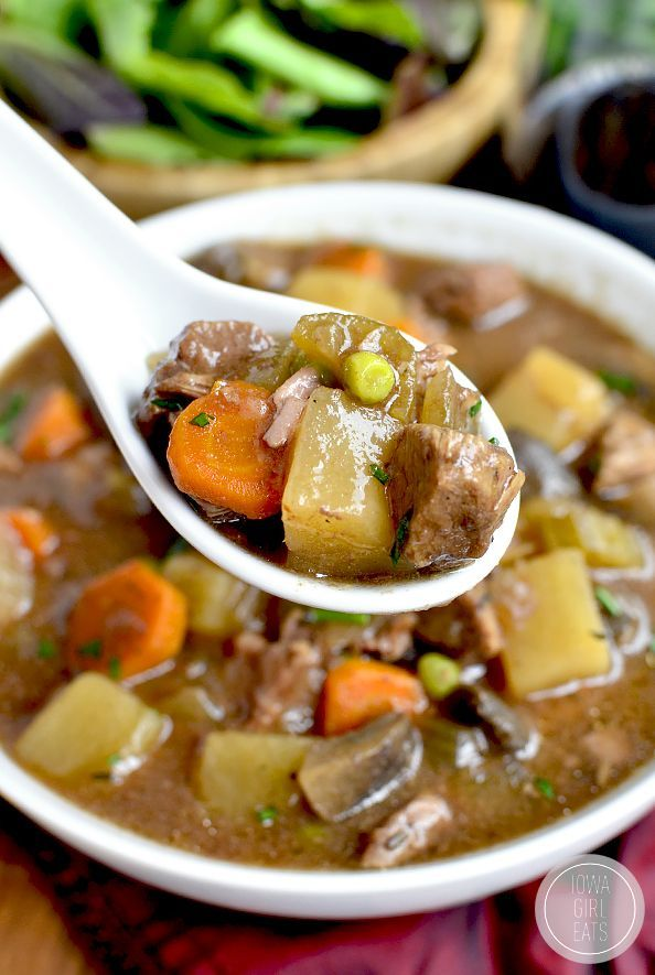 Crock Pot Beef Stew is easy, hearty, and comforting. Toss everything into the crock pot at night then pop into the base and cook the next day!   iowagirleats.com