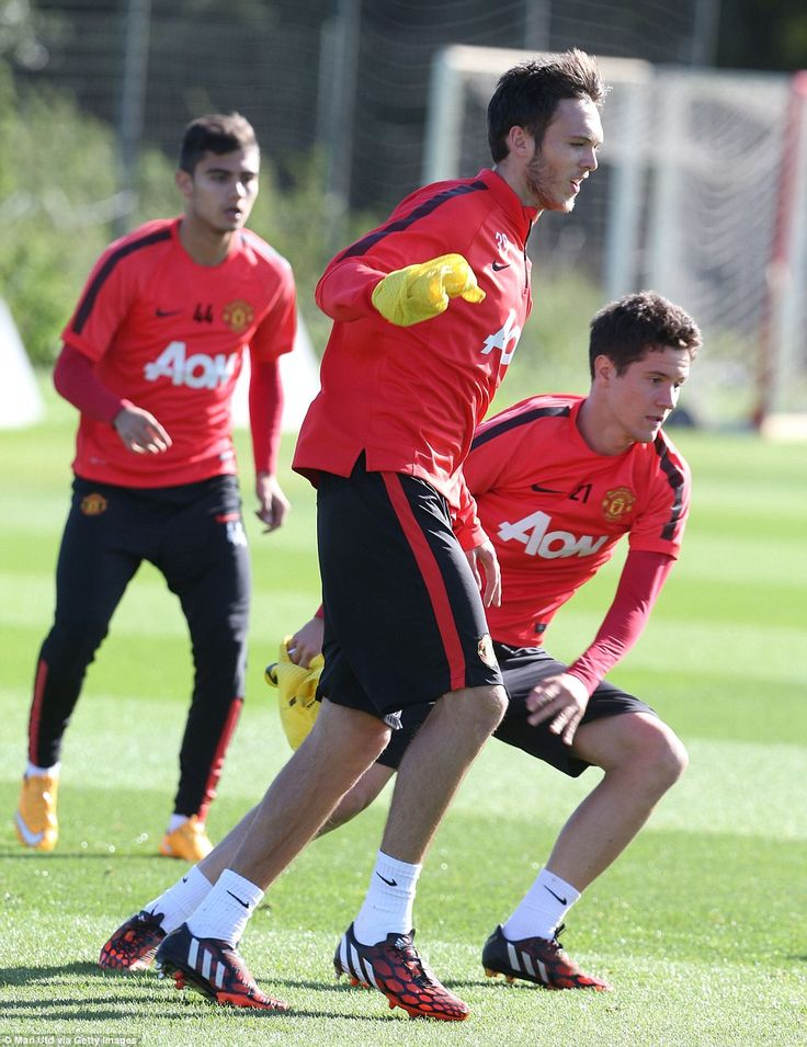 Thorpe, centre, jostles with United's summer signing Ander Herrera as the Red Devils prepa...