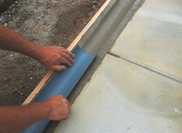 Creating a concrete drainage channel.