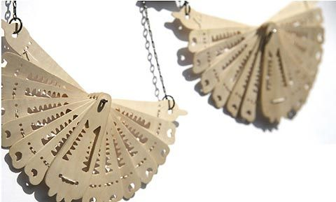 I love the way that the fan is layered in this picture. Must think of how I can use this look in our jewellery range