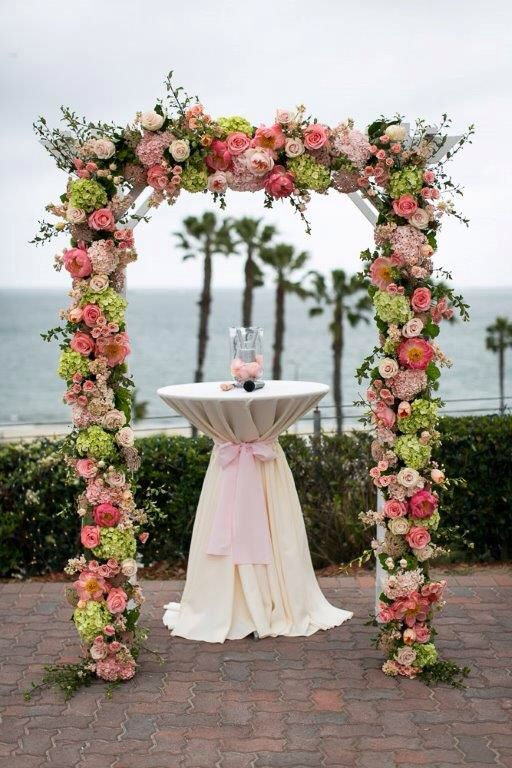 Floral archway Pink, green, coral, peach wedding flowers Floral design by Romance Etc. | Belmont Shore, CA  www.romance-etc.com Photography by SherriJ | Huntington Beach, CA | www.sherrijphotography.com