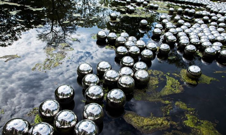"Yayoi Kusama installed ""Dots Obsession"" at Philip Johnson's Glass House in…"