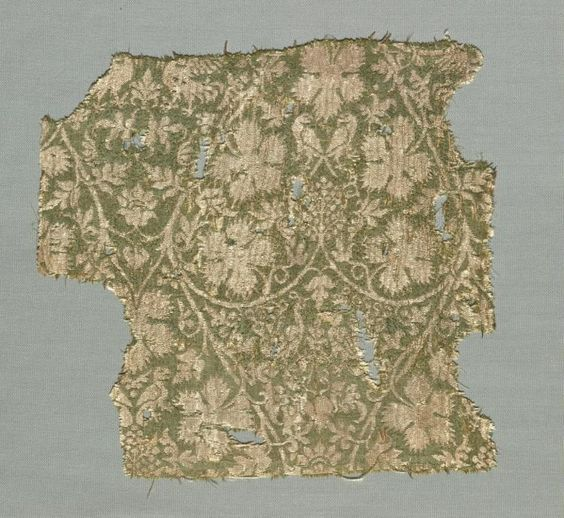 "This textile piece is called, ""Silk Fragment with Scrolling Vines, Grape Leaves, Grapes and Birds."" It is from Italy and dates back between 1325-1350 C.E. The fragment is made out of silk with a combination of two weaves: the plain weave and lampas. According to the museum, this silk fragment displays a revolutionary new fashion in Italian textile design, influenced by the exotic patterns from China, Byzantium, and Islamic countries of the Near East. Keeps its Italian look with the grapes…"