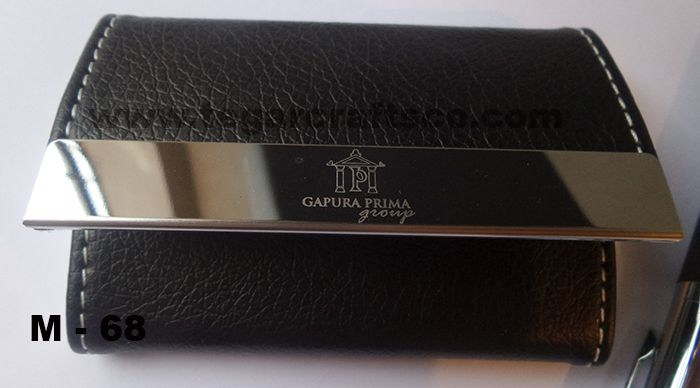M68: a business card holder and pen with print logo and personalized employer's name to be distributed as awards of achievement and dedicated employees during the year. Ordered by PT Gapura Prima Group, Jakarta.