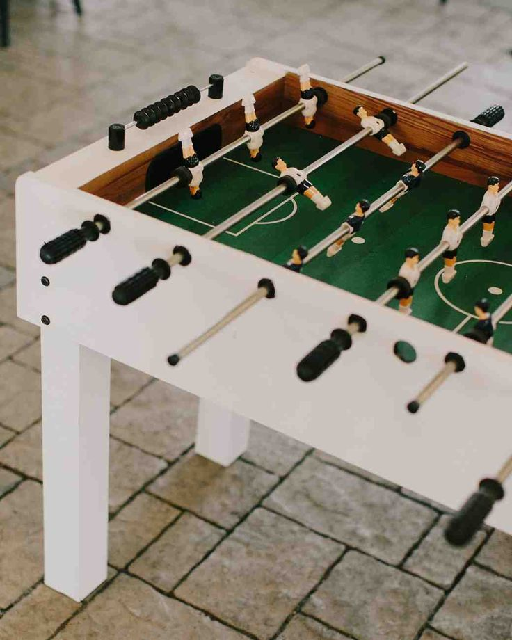 20 Things All Laid-Back Brides Do | Martha Stewart Weddings -- This bride and groom met during a carefree game of foosball, so it was only fitting that their wedding reception have the same unexpected form of entertainment.