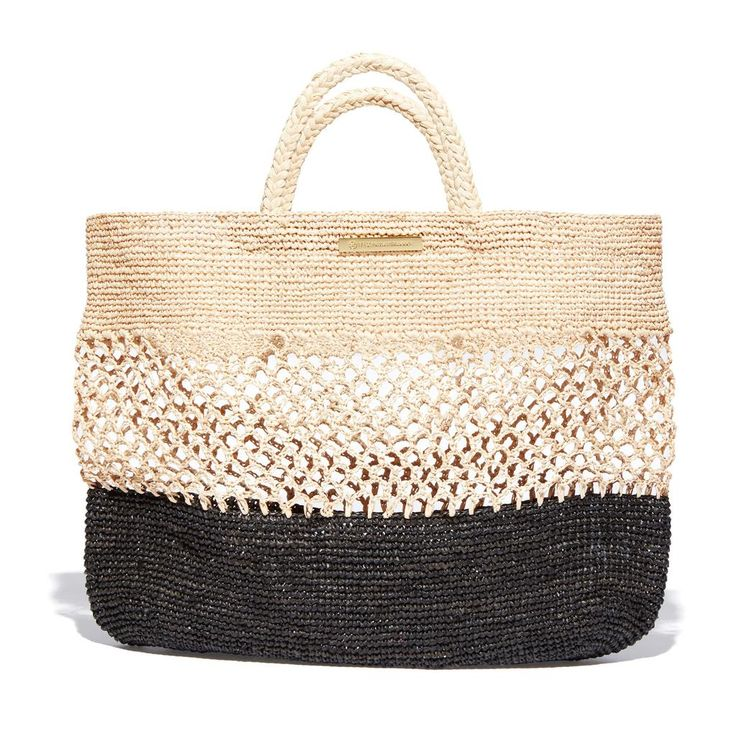 Meet the ultimate beach bag: handmade in two-tone raffia, it's sized just right for an oversize towel, summer reads, and all the sunscreen you'd ever need. 100%