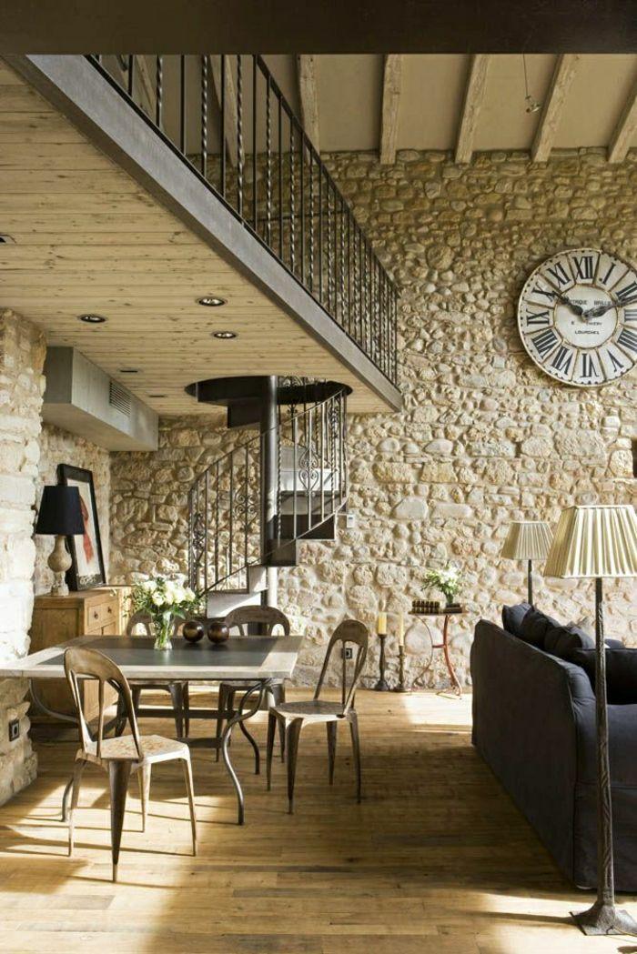 joli salon dans les maisons familiales de vacances , salon d'esprit rustique avec murs en pierres