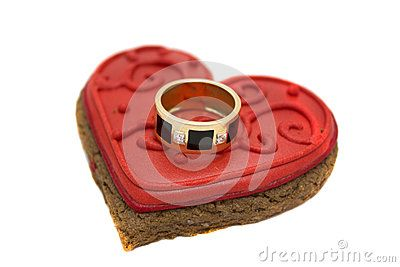 Gold ring lies on the heart from cookie