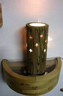 Lampe aus Rundholzbalken