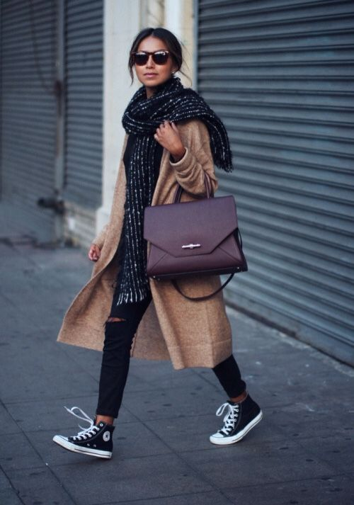 Great street style skinny ripped black jeans, camel coat and converse high-tops - just fab