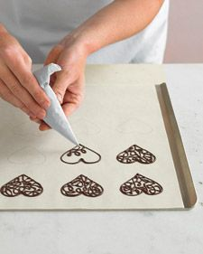 How to make chocolate lace hearts for cakes, cupcakes, ice-cream, etc. Looks gorgeous but I'm not sure I could manage it!