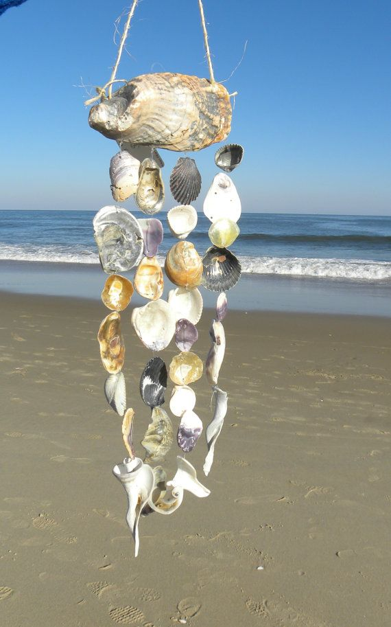 Instead as a wind chime, could use this idea as a curtain of sea shells rather than having a blind