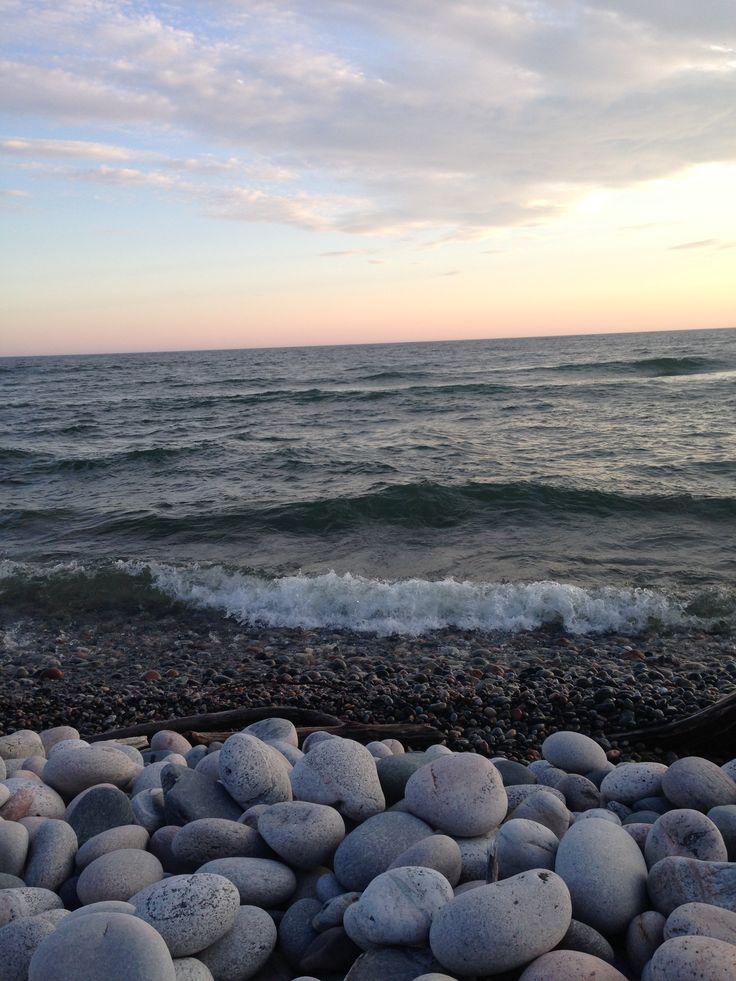 water waves clouds pebbles/rocks